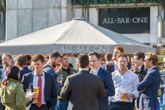 All Bar One, a pub with outdoor space in Canary Wharf packed wit. London, UK - May 10, 2017 - All Bar One, a pub with outdoor space in Canary Wharf packed with Royalty Free Stock Photo