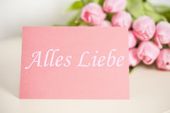 All the best card & x28;german& x29;. With tulips in background stock photography