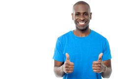 All the best mate !. Smiling man showing double thumbs up to the camera Royalty Free Stock Photo