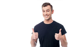 All the best my friend !. Smiling man showing double thumbs up gesture Stock Photography