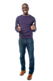 All the best! Work hard, do well. Smart young man showing double thumbs up Royalty Free Stock Image