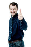All the best for your business!. Smiling business executive showing thumbs up gesture Stock Photography