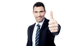 All the best for your business!. Successful businessman showing thumbs up gesture Royalty Free Stock Photography