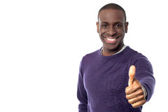 All the best for your exams. Smiling young man with showing thumbs up Royalty Free Stock Photos
