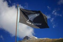 All Blacks New Zealnd flag on a sky. All Blacks New Zealnd flag. Location: New Zealand Aotearoa Royalty Free Stock Photo