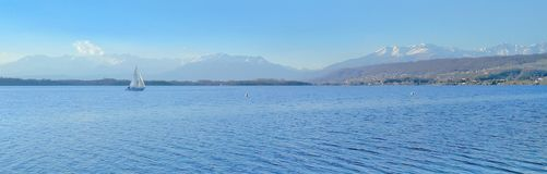 All blue panoramic lake. Scenic lake panorama with a boat royalty free stock photo