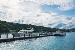 Sun moon lake. All these boats are belong to different boat operators which fetching tourists from places to places through Sun Moon Lake royalty free stock photo