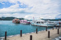 Sun moon lake. All these boats are belong to different boat operators which fetching tourists from places to places through Sun Moon Lake stock photos