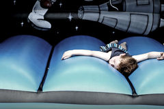 All bounced out. Little boy laying down all worn out on a bouncy castle Royalty Free Stock Photos
