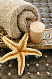 All brown. A towel, a candle, and a starfish Royalty Free Stock Image