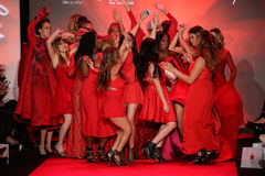 All Celebrities dance onstage on the runway at the Go Red For Women Red Dress Collection 2015 Stock Photo