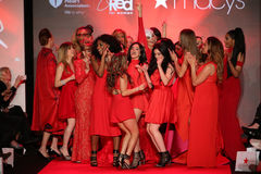 All Celebrities dance on stage on the runway at the Go Red For Women Red Dress Collection 2015 Stock Photo