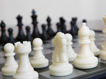 All chess pieces on a board Stock Images