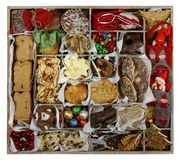All Christmas Concept: Storage Box width Cookies and Ornaments. Sectioned storage box width a selection of sorted Christmas items: cookies, candies, Christmas stock images