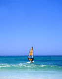 All clear. Windsurfer off the coast of Fuerteventura, one of the Canary Islands, in the Atlantic Ocean royalty free stock photos