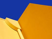 It' all about colour. Yellow rendering against a deep blue sky Stock Photos