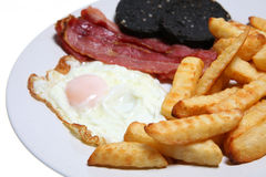 All-Day Breakfast. Traditional fry-up with bacon, eggs, black-pudding and fries Stock Photography