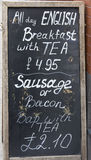 All Day English Breakfast blackboard sign outside a cafe in England. Royalty Free Stock Photography