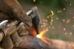 All In a days Work. Close up of Glove and torch cutting steel Royalty Free Stock Photography