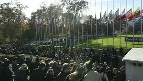 All European Union Flags half-mast and Council of Europe employees leaving the COE building stock video footage