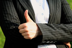 All is excellent. Hand gesture meaning all is excellent against a business suit Royalty Free Stock Images