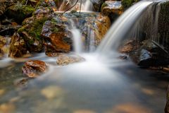 All Fall Together. Slow exposure waterfall slowly flowing of the rocks up close Royalty Free Stock Image