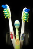 All family tooth-brushes. All family (three) tooth-brushes on the black background Stock Image