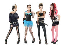 All female rock band members posing over white background Stock Image