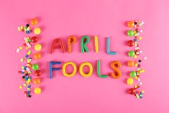 All fools day background concept with holiday accessories, April 1st themed party attributes. Close up, copy space, top view, flat stock photos