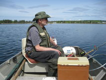 All geared and waiting for the fish to bite. Cool fisherman already to have a good day of fishing stock photography