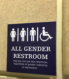 All gender restroom sign. All gender restroom sign in convention center in Orlando, Florida stock photo