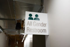 All Gender Restroom. Sign at a school indoors showing that all genders are equal here royalty free stock photo