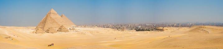 All Giza Pyramids Panorama Cairo Cityscape. A grand panorama of all of the pyramids at Giza and the city of Cairo, Egypt nearby Stock Photos