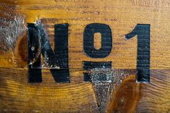 All the glamour is gone: Number one painted on old wood box stock photography