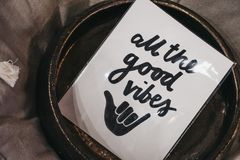 All the good vibes motivational quote. In the interior, shallow focus royalty free stock photography