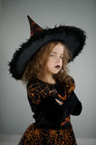 All Hallows Eve. Beautiful girl 8-9 years in image the evil sorcerers. All Hallows Eve. Beautiful girl 8-9 years in image the evil sorcerer. She is dressed in royalty free stock photography