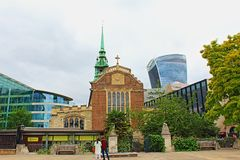 Ancient church and modern architecture City of London England United Kingdom stock image