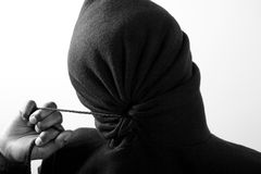 Boy all hoodied up. Boy in hoodie with face fully covered in black and white Stock Images