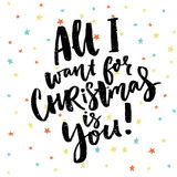 All I wand for Christmas is you. Funny saying for Christmas cards, black brush calligraphy on stars background. Stock Photos