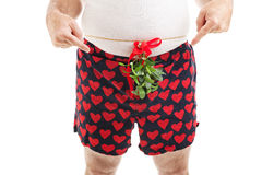 All I Want For Christmas. Guy with Christmas mistletoe around his waist, pointing at his crotch and asking for oral sex. White background stock photos