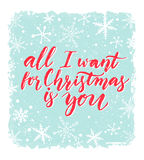 All I want for Christmas is you. Greeting card with romantic saying. Red calligraphy at blue background with snowflakes Stock Photos