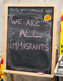 We are all immigrants. Anti UKIP and Farage message at a stall Royalty Free Stock Photography