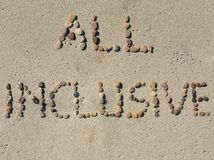All inclusive text on the beach sand. All inclusive text written on the beach sand Royalty Free Stock Photos