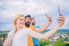 We are all individuals. People enjoy selfie shooting on nature. Best friends taking selfie with camera phone. Sexy girl royalty free stock photo