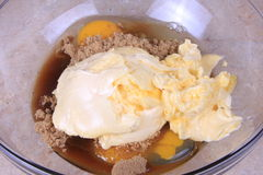 All the ingredents together. Butter , sugar vanilla and eggs in a bowl waiting to be mixed stock photography
