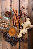 Christmas spices on a wood background Royalty Free Stock Image