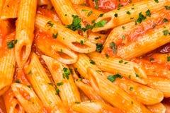 all italiensk pastapenne för arrabbiata Arkivfoto