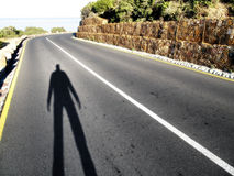 All journeys begin with... Landscape photo of the shadow of a person contemplating a journey royalty free stock photography