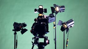 All the lights of a filming set are turning on one by one. 4K stock video footage