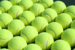 All Lined Up. Rows and rows of Tennis balls Stock Image